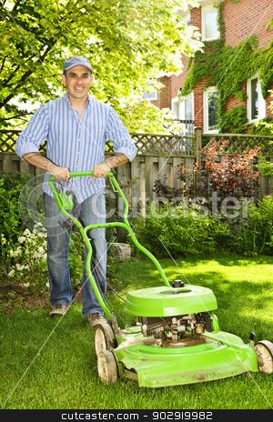 Man mowing lawn stock photo, Man with lawn mower in landscaped backyard by Elena Elisseeva