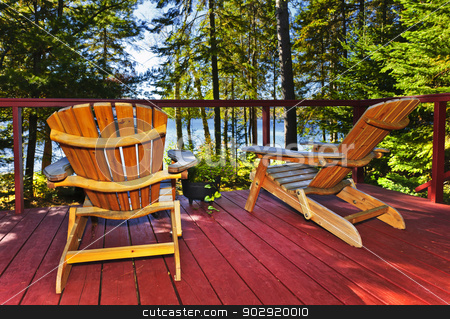 Forest cottage deck and chairs stock photo, Wooden deck at forest cottage with Adirondack chairs by Elena Elisseeva