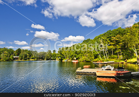 Cottages on lake with docks stock photo, Beautiful lake with docks in Ontario Canada cottage country by Elena Elisseeva