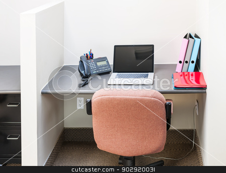 Office cubicle with laptop computer stock photo, Workstation in office with swivel chair desk and laptop computer by Elena Elisseeva