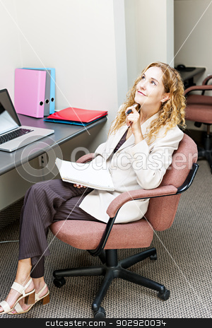 Business woman thinking at office desk stock photo, Businesswoman thinking of ideas in office workstation looking up by Elena Elisseeva