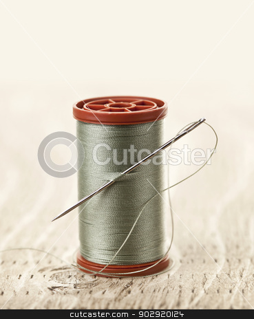Thread and needle stock photo, Spool of thread with needle for sewing by Elena Elisseeva