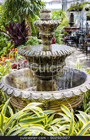 Concrete fountain in garden center stock photo, Cascading concrete fountain in garden nursery store with water flowing by Elena Elisseeva