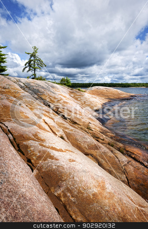 Rocky shore in Georgian Bay stock photo, Smooth rocky lake shore of Georgian Bay in Killbear provincial park near Parry Sound, Ontario, Canada. by Elena Elisseeva