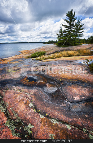 Rocky shore in Georgian Bay stock photo, Rocky lake shore of Georgian Bay in Killbear provincial park near Parry Sound, Ontario Canada by Elena Elisseeva
