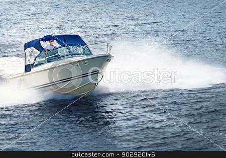 Man boating on lake stock photo, Man piloting motorboat on lake in Georgian Bay, Ontario, Canada. by Elena Elisseeva