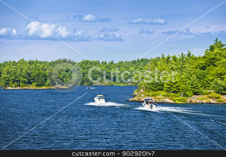 Boats on Georgian Bay stock photo, Recreational boats on blue waters of Georgian Bay near Parry Sound, Ontario Canada by Elena Elisseeva