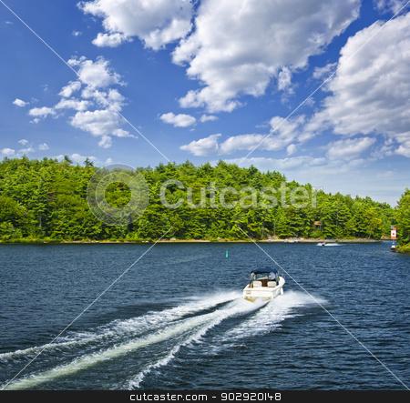 Boating on lake stock photo, Motorboat on summer lake in Georgian Bay, Ontario, Canada by Elena Elisseeva
