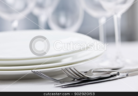 Plates and cutlery stock photo, Elegant restaurant table setting for fine dining with plates cutlery and stemware by Elena Elisseeva