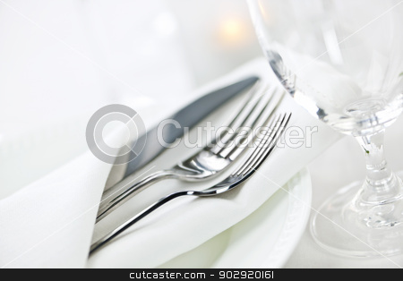 Table setting for fine dining stock photo, Elegant restaurant table setting for fine dining with plates cutlery and stemware by Elena Elisseeva