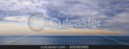 Panorama of sky over water stock photo, Panoramic view of dramatic sunset sky over vast ocean by Elena Elisseeva
