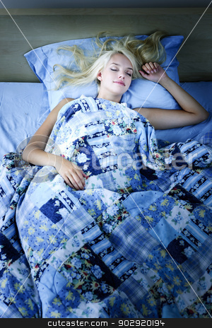 Woman sleeping in bed at night stock photo, Young woman sleeping peacefully at night in bed by Elena Elisseeva