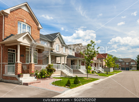 Suburban homes stock photo, Suburban residential street with red brick houses by Elena Elisseeva
