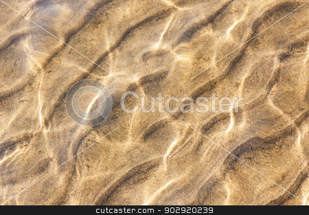 Water and sand ripples stock photo, Water and sand ripples background with sun reflections by Elena Elisseeva