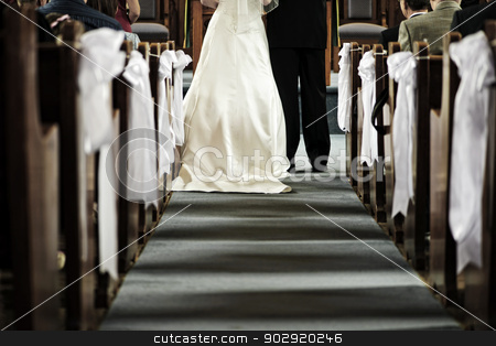Wedding in church stock photo, Bride and groom getting married in church view from aisle by Elena Elisseeva