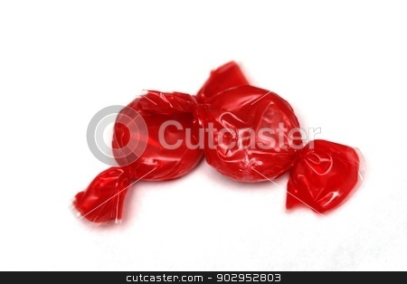 Candy stock photo, Two pieces of red candy on a white background by Karma Shuford