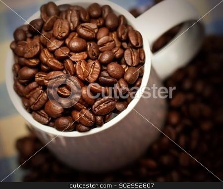 Coffee stock photo, Coffee beans in a white mug by Karma Shuford