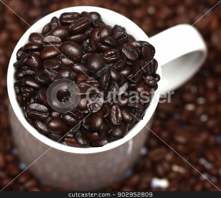 Coffee stock photo, Coffee beans in a white mug by Karma Shuford