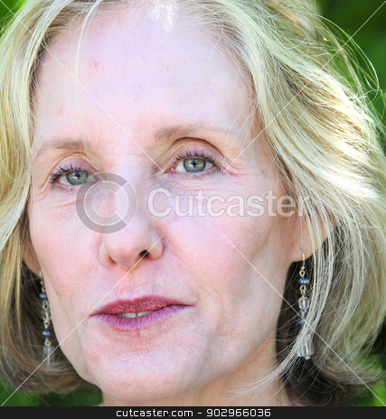 Mature female beauty stock photo, Mature female blond beauty posing outside. by OSCAR Williams