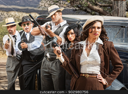 Pretty Gangster with Mob stock photo, Pretty woman with submachine and gangsters by car by Scott Griessel