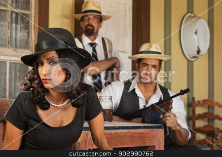 1920s Era Bootleggers stock photo, Serious gangster woman with bootleggers at table by Scott Griessel