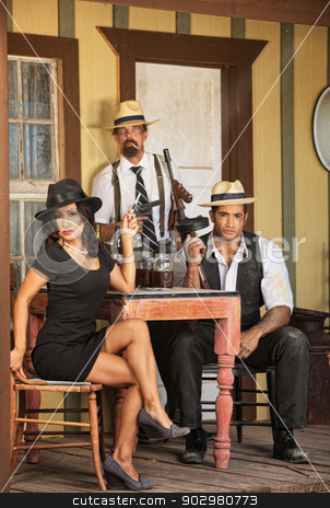 Three Retro Bootleggers with Weapons stock photo, Three criminal gangsters with weapons and whiskey by Scott Griessel