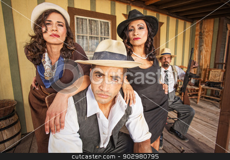 Tough Gangster with Pretty Women stock photo, Tough 1920s gangster surrounded by pretty women outside by Scott Griessel