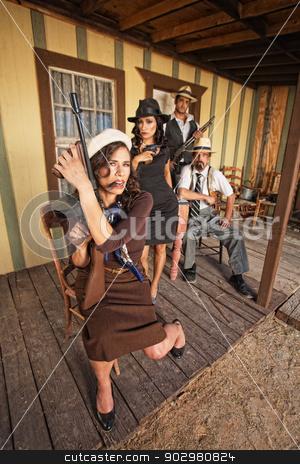 Cigar Smoking Armed Female Gangster stock photo, Cigar smoking female gangster holding a submachine gun by Scott Griessel