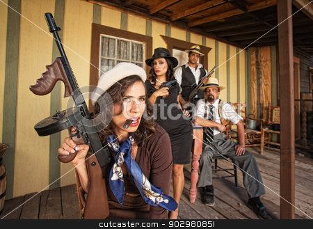 Tough Smoking Woman with Submachine Gun stock photo, Tough gangster woman with cigar and submachine gun by Scott Griessel