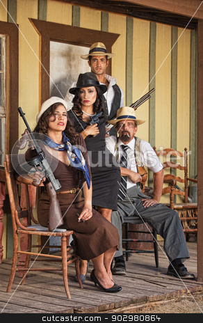 Four Tough Gangsters stock photo, Four tough male and female gangsters sitting with weapons by Scott Griessel