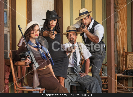1920s Era Gangsters Aiming Guns stock photo, Group of four 1920s vintage gangsters aiming their guns by Scott Griessel