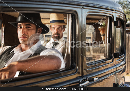 Watchful Pair of 1920s Gangsters stock photo, Pair of 1920s gangsters watching from a car by Scott Griessel
