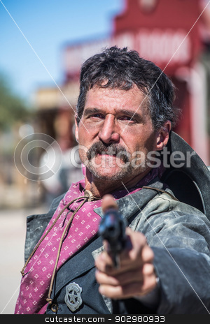 Stern Cowboy Points gun stock photo, Serious Cowboy Points Gun at You by Scott Griessel