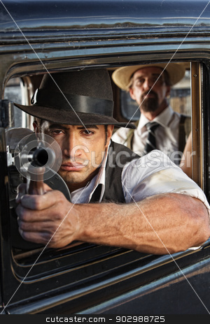 Muscular Gangster Shooting Gun stock photo, 1920s vintage gangsters shooting submachine gun from car by Scott Griessel