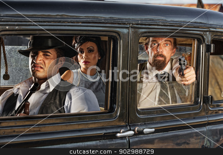 1920s Era Gangsters Drive By stock photo, Group of 1920s vintage gangsters in drive by shooting by Scott Griessel