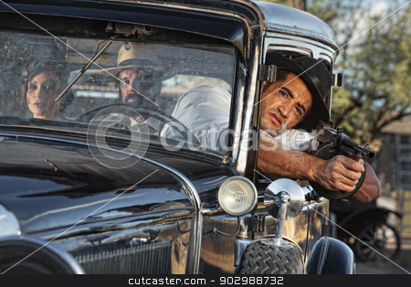 1920s Gangster Drive By Shooting stock photo, 1920s vintage gangsters drive by shooting by Scott Griessel
