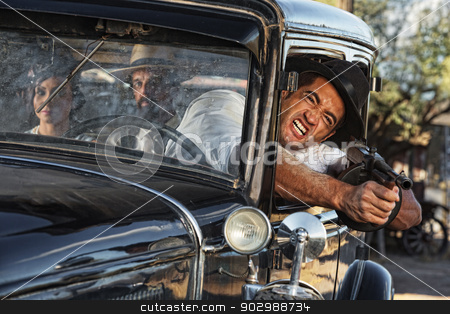 Aggressive Gangster Shooting from Car stock photo, 1920s gangster shooting gun from car window by Scott Griessel