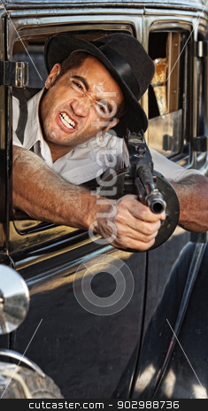 Angry Gangster Shooting Gun stock photo, 1920s vintage gangster shooting gun from car window by Scott Griessel