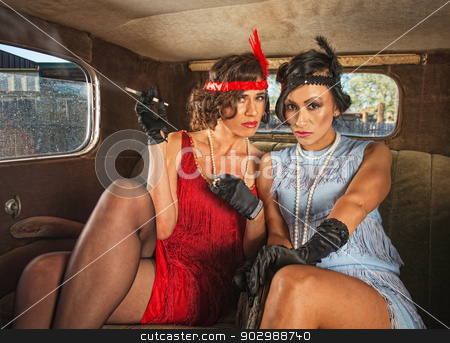 Serious Retro Smoking Ladies stock photo, Two serious retro flapper women smoking in antique car by Scott Griessel
