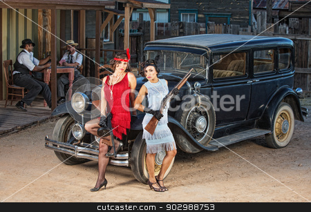 Group of Gangsters Near Old Car stock photo, Group of 1920s gangsters near old car with guns by Scott Griessel