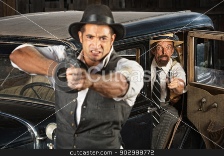 Angry 1920s Era Gangsters with Guns stock photo, Angry 1920s vintage gangsters at car with weapons by Scott Griessel