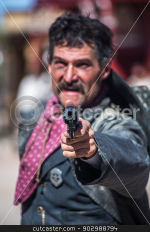 Sheriff Points Gun stock photo, Sheriff Points Gun at You in the Middle of Town by Scott Griessel