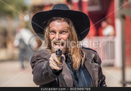 Cowboy Points Gun at You stock photo, Cowboy Points Gun at You in Town by Scott Griessel