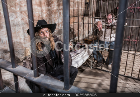 Two Imprisoned Men stock photo, Two Imprisoned Men Wait in Jail Cell by Scott Griessel
