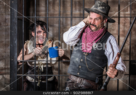 Female Prisoner Makes Noise stock photo, Femal Prisoner Protests to Her Situation by Making a Ruckus by Scott Griessel