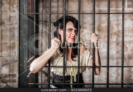 Portrait of Sneering Female Prisoner stock photo, Portrait of a Sneering Female Prisoner in the Oldwest by Scott Griessel