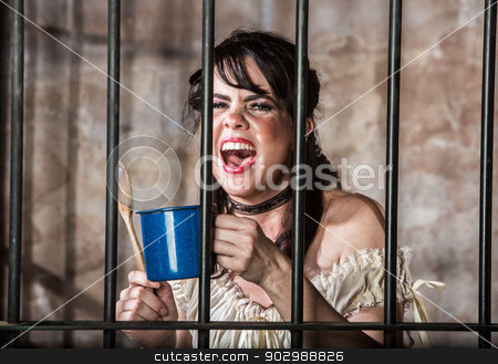 Portrait of Screaming Female Prisoner stock photo, Portrait of a Screaming Female Prisoner in the Old West by Scott Griessel