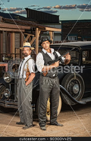 Criminal Partners stock photo, 1920s era criminal partners with guns outdoors by Scott Griessel