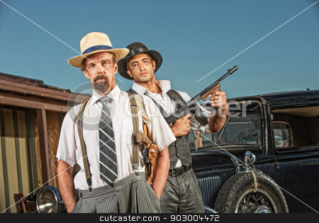 1920s Era Gangster Partners stock photo, Tough gangster with hands in pockets with armed guard by Scott Griessel