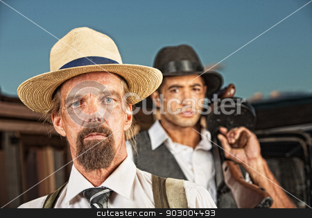 Pair of 1920s Era Gangsters  stock photo, Pair of 1920s vintage gangsters in hats outside by Scott Griessel